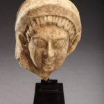 TERRACOTTA FEMALE HEAD PROTOME