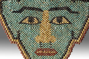 MULTICOLOURED FAIENCE MUMMY FACE MASK detail