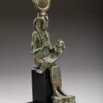 bronze figure of seated isis suckling horus