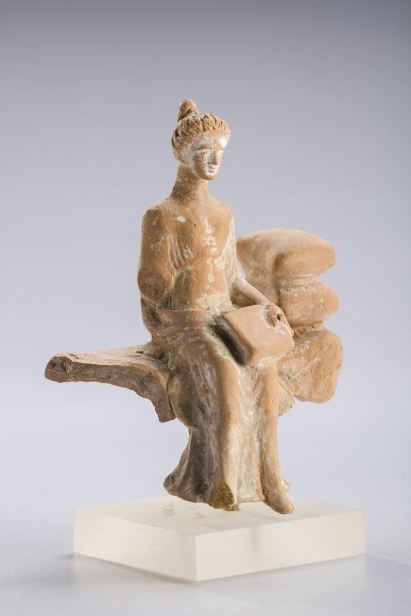 |corinthian terracotta seated female