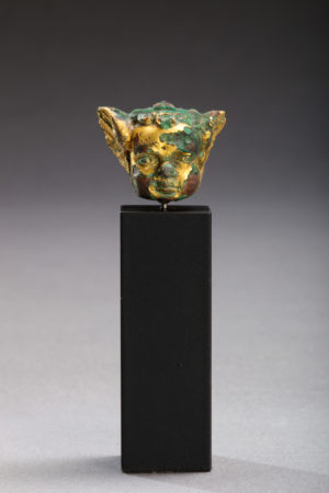 small gilded bronze head of amor