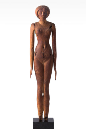 wood statue of naked female